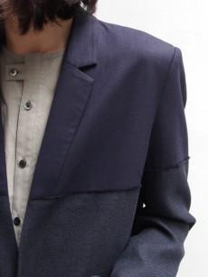 ffiXXedのミニマルなデザインのテーラードジャケット